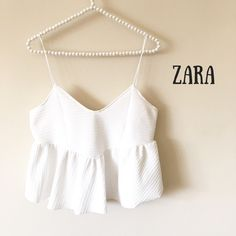 """Zara White Peplum Crop Top Gently used, with minor mark on front (see last photo)  Size Medium  100% Polyester  Length: 22""""  Chest: 36"""" Zara Tops Crop Tops"""