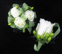 Light Green ribbon, black gypsophila, and little green Hypericum Berries in this custom corsage.