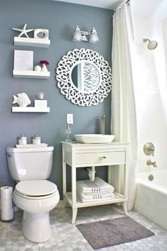 Image from http://lindaberner.com/wp-content/uploads/2015/08/vintage-look-small-and-narrow-bathroom-spaces-with-beach-inspired-theme-and-DIY-wooden-vanity-with-towel-rack-and-storage-under-round-mirror-and-beach-accessories-decoration-ideas.jpg.
