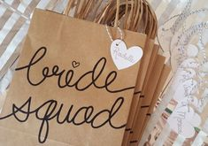 Bride Squad Gifts Bags for Bachelorette Party, Medium Kraft Bags with Handles, Hand Lettered, Sturdy Bottom, different font color choices Bride Squad Brown Kraft Geschenktüten mit Griffen und stabilem Hen Party Bags, Party Gift Bags, Party Gifts, Bride Squad, Team Bride, Bachelorette Gift Bags, Bachelorette Weekend, Bridesmaid Proposal Gifts, Bridesmaid Gift Bags
