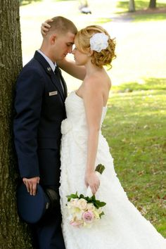 Standing against a tree or wall, have groom bend inside leg at the knee