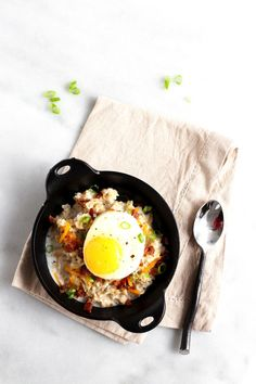 A protein-packed savory oatmeal topped with egg, bacon and cheese. Nutrition Information: Calories: 467; Total Fat: 23g; Saturated Fat: 8g; Monounsaturated Fat: 2g; Polyunsaturated Fat: 1g; Cholesterol: 230mg; Sodium: 520mg; Potassium: 442mg; Total Carbohydrate: 39g; Dietary Fiber: 3g; Sugars: 13g; Protein: 25g; Vitamin A: 18%; Vitamin C: 2%; Calcium: 38%; Iron: 13%