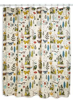 A menagerie of butterflies, sea artifacts, terrariums, and feathers adorns the dotted fabric of this shower curtain