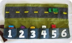 roll up car track - could be a good numeracy practice as well.  Maybe put stickers on each car to correspond to the numbers on the pockets?