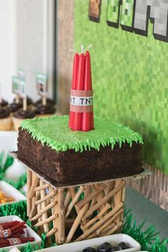 The birthday cake at this Minecraft Birthday Party is incredible!! Love the TNT candles!! See more party ideas and share yours at CatchMyParty.com #catchmyparty #minecraftbirthdayparty #minecraftbirthdaycake