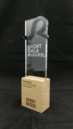 Award in clear acrylic with solid oak base