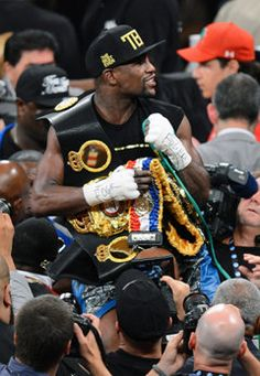 The Champ is here! Floyd Mayweather celebrates his big win. (Getty) #TMT #MoneyTeam #Boxing