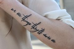 Beautiful quote tattoo on arms