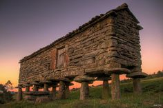 Old corn crib (horreo),Galicia, Spain Brick And Stone, Stone Work, Stone Masonry, Dry Stone, Famous Castles, Vernacular Architecture, House On The Rock, Spain And Portugal, Water Tower