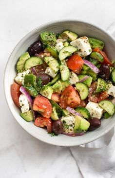 This avocado Greek salad recipe is healthy, fast, and bursting with fresh Mediterranean flavors. This salad is delicious and good for you! This Greek salad with avocado is the perfect make-ahead salad for potlucks, picnics, Avocado Salad Recipes, Greek Salad Recipes, Chicken Salad Recipes, Healthy Salad Recipes, Healthy Snacks, Vegetarian Recipes, Healthy Eating, Cooking Recipes, Spinach Salads