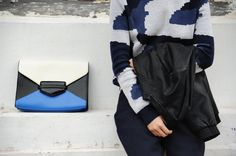 Clock Block Clutch & Leather Biker Jacket from Topshop, Camouflage Sweater from ASOS