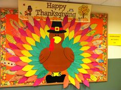 Kindergarteners are thankful for... Thanksgiving bulletin board. Each kindergarten class did a different color feather and we put it all together!