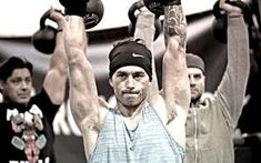 Train Your Body to Love Holding Heavy Weights Overhead