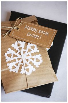 kraft paper with white snowflake gift wrap- use this concept with any holiday or celebration. For a birthday you could use a birthday hat or cake cut out.