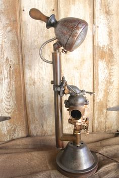 This is a handcrafted lamp designed and assembled by Anvil Industrik.  This lamp was assembled using a variety of repurposed parts, including a