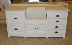 From The Milestone Kitchens French Flair Range. Custom Made Butlers Sink Unit with Pot Drawers and Cutlery Drawer.