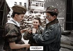 """The Warsaw Uprising Two nurses and a soldier (right) from Battalion """"Parasol"""" after coming out of sewers at ul. Warecka near Nowy Świat. In the center is Maria Stypułkowska-Chojecka """"Kama"""", on the right Krzysztof Palester """"Krzych"""". Warsaw Ghetto Uprising, Poland Ww2, Warsaw Poland, History Magazine, Red Army, My Heritage, World History, History Class, Armed Forces"""