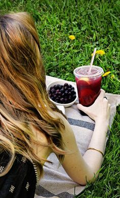 A moment alone with a good book and an amazing summer drink, like this Blueberry Pineapple FruiTea Chillers.