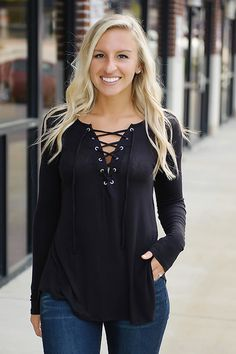Trendsetter chic! This long sleeve top rocks the lace up trend in a fun, edgy way! Perfect to pair with your favorite denim & boots for a fab look all season long!