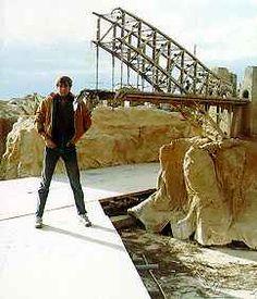 Crew member standing next to Sydney Harbour Bridge miniature