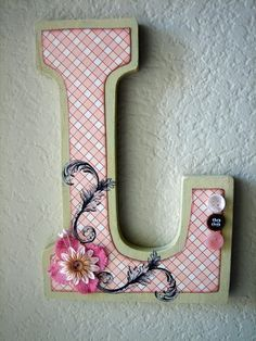 "Personalized Wooden Monogram Wall Letter by LolaMonkey on Etsy  Measuring in at 8 3/4"" high and 5 1/2"" wide, this chunky block letter comes decorated and personalized to match your color scheme. Ready to hang on the wall using the pre-cut notch, or you can stand it up on a table, shelf, bookcase, etc."
