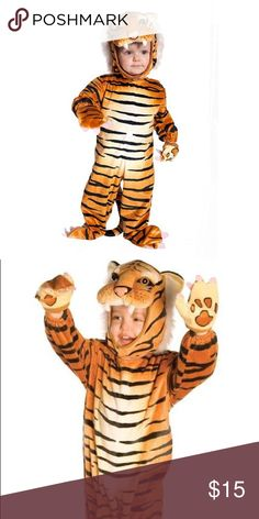 Adorable Tiger Costume size 2T Plush & warm This adorable jumpsuit is has a Velcro closure in the back for a quick and comfortable fit. The plush tail is attached as are the matching shoe covers so your little one can look like a tiger from head to toe! Put on the tiger headpiece and paw mitts to complete the look. This toddler tiger costume will also keep your little one warm on a cool Halloween night out trick-treating. Costume comes with adjustable Velcro headpiece, jumpsuit with attached…