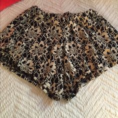 Brandy Melville high waisted fabric shorts Brandy Melville fabric shorts- one size fits all with elastic waist band. Cream and black floral print. Lace texture with black lining under. Worn a couple times! Brandy Melville Shorts