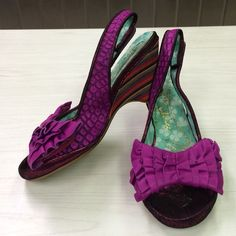 Sassy flashy peep toe Wedges These shoes are over the top!!! Wild purple alligator print textured shoes with leather ruffle bow at the toes.  Adjustable Velcro sling back strap. Purple sparkle glitter front at the sole.  Wooden multicolor stripe wedge heel.  These shoes have been worn, but still have lots of wear in them.  A true show stopper!!! Size 7.5 bi irregular  Choice irregular choice Shoes