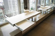 Tribeca penthouse. Wall hung SWE1Lagoon sink with recessed make up drawer. Material Corian