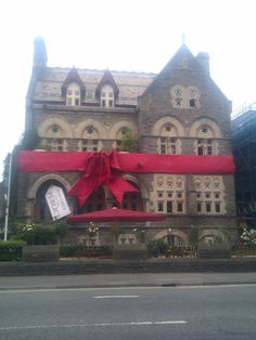Big red ribbon on Park House in Cardiff.
