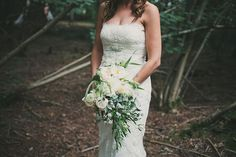 Image by Maureen du Preez - Bride in a Lace Pronovias Gown with flower crown for an outdoor woodland wedding at Wise Wedding Venue in Kent with Festival Theme and Cheese Tower Wedding Cake.