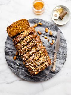 A Maple Earl Grey Tea cake recipe lightly sweet, vegan, & gluten free! A buttery tea cake loaf infused with Earl Grey tea, cardamon, topped with almonds.