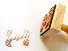 We're loving Enon Avital's screened style custom rubber stamp.