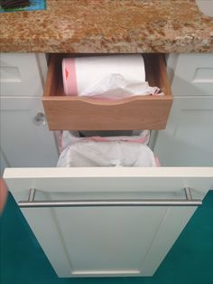 Hidden drawer inside garbage drawer for the bags! *** if you made a slit or slot in drawer you could feed your bags thru for easy tear off.