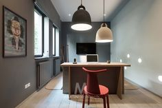 A Sleek Apartment the Divides Rooms Creatively