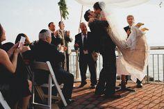 sexy wedding ceremony first kiss photo by AGAimages | via junebugweddings.com