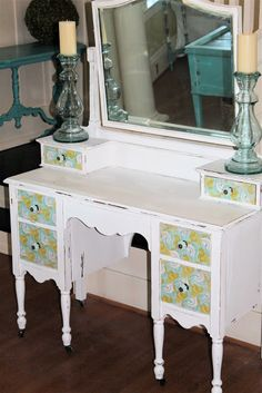 I like the shabby chic distressed look with the hip vintage paper on the drawer fronts