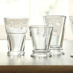 We love the Bee Glassware Collection, especially for casual dinners where it's all about the drinks and great conversation. Made of nicely weighted, molded glass embossed with honey bees, a traditional symbol of French royalty. Bee Glassware features:Available in three styles for your tableDishwasher safeImported from France