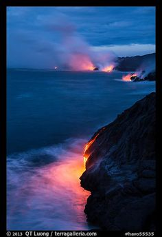 Molten lava pouring over sea cliffs at dawn. Hawaii Volcanoes National Park,Part of gallery of color pictures of US National Parks by professional photographer QT Luong, available as prints or for licensing. Hawaii Volcanoes National Park, Volcano National Park, American National Parks, Us National Parks, Oahu Vacation, Vacation Places, Volcano Pictures, National Park Lodges, Vacations To Go