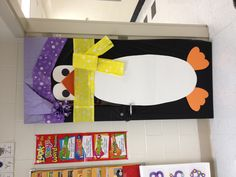 "To promote an outdoor movie event at school showing the movie ""Happy Feet"", decorate the classroom doors with a penguin design.    - Southern Outdoor Cinema event planning tip for promoting a movie night at school."