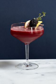 Blackberry cocktail with thyme garnish
