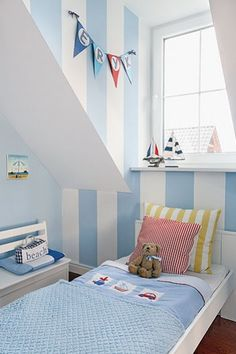 Love the blue and white stripes with matching bedding and incidental decorative touches in blue and white. Teddy Bear is a true mark of a #kids_room..