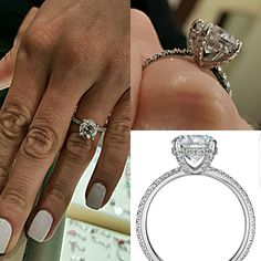 Absolutely stunning engagement ring. Round solitaire with thin diamond pave band.