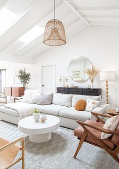 modern living room wtih shiplap ceiling, rattan chandelier and modern sectional sofa with modern leather anad wood armchair neutral living room design, modern farmhouse living room decor ideas, modern meets traditional living room makeover Home Interior, Living Room Interior, Living Room Furniture, Interior Design, White Couch Living Room, Furniture Stores, Room And Board Living Room, Neutral Living Rooms, Boho Chic Interior