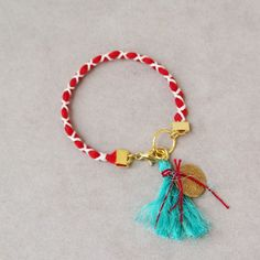 Red white friendship bracelet, Greek folk bracelet, red white Martis bracelet with gold coin charm and turquoise tassel, braided boho cuff Fabric Bracelets, Cord Bracelets, Gold Coins, It's Easy, Boho Jewelry, Friendship Bracelets, Tassel Necklace, Macrame, Red And White