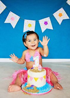 Never been happier to destroy her beach themed cake during her Cake Smash!   Iliasis Muniz Photography The Painted Box, Cake Smash Photography, Beach themed Cake Smash, Beach Cake, One Year Old, Hawaiian Banner, Beach themed baby outfits, Pink Bikini and hula skirt, Cake Shells.