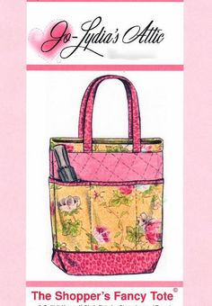 Free Pattern! Double-faced, quilted fabric is the backdrop for contrasting divided pockets and the bottom panel on the outside of this pretty tote bag. by Barbara Weiland