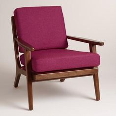 Textured fuchsia cushions with a subtle two-tone weave pop against a sleek wood frame finished in dark espresso. This mid-century-inspired chair boasts a vertical slatted back and a deep seat for comfortable lounging.