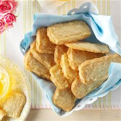 Slice & Bake Coconut Shortbread Cookies Recipe -Light and buttery, these delicate shortbread cookies are melt-in-your-mouth good. The coconut flavor makes them extra-special. They were made to nestle beside a teacup. —Roberta Otto, Duluth, Minnesota
