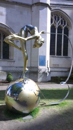 "theme #Gold - this beautiful sculpture was on display at Westminster Abbey during the #London2012 Olympics . statue stands outside Westminster Abbey. Part of a group of five sculptures installed in, and around, the Abbey with the assistance of More Than Gold.  The statue is dedicated to Francesca ""Frankie"" Jones. She is the top ranked rhythmic gymnast in Great Britain. Artist Eleanor Cardozo"